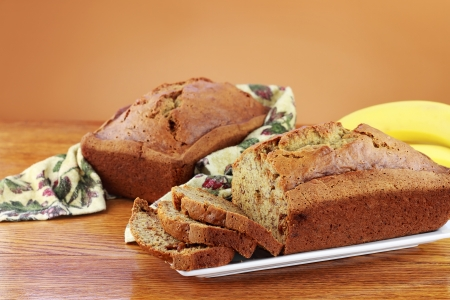 Homemade banana bread with fresh bananas and copyspace.
