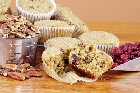 whole pecans: Oatmeal Cranberry Muffins made with dried cranberries, oats, whole wheat flour, pecans and dried cranberries.