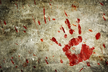 Bloody hand print and blood splatter on a grungy wall. photo
