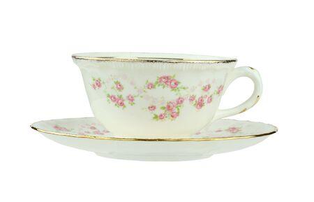 Flowered antique tea cup and saucer isolated on a white background with clipping path.  Stock Photo