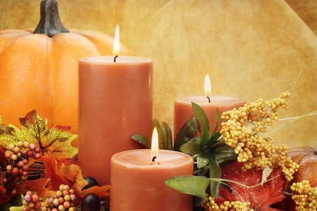 Lit candles surrounded by autumn decorations. Copy space available.  photo