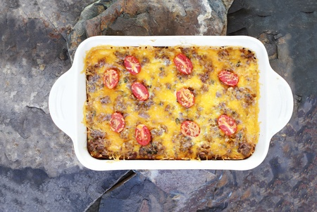 hash: Hash Brown Strata or Breakfast Casserole made with a crust of hash browns, eggs, sausage and cheddar cheese.  Stock Photo