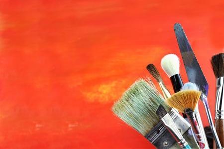 Paintbrushes against a grunge background. photo
