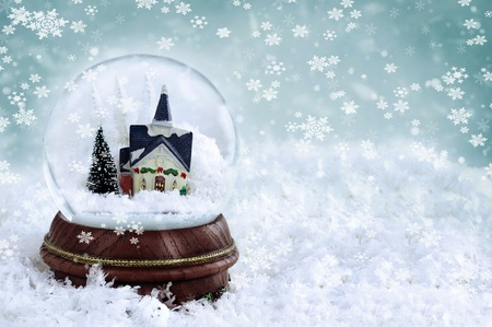 snow globe: Snow globe with church and christmas trees inside