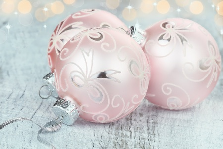Pink Christmas ornaments lying on a rustic table. Shallow depth of field. Stock Photo - 11466410