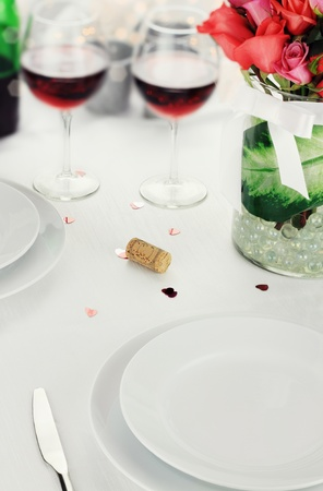 Romantic table setting with selective focus on lower portion of image. Stock Photo
