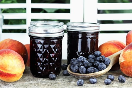Homemade canned blueberry peach preserves with fresh blueberries and peaches.