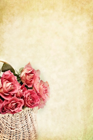 long day: Basket of pink long stem roses with copy space available.