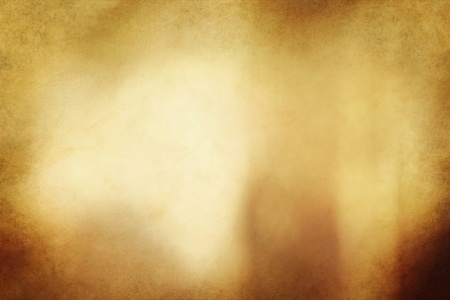 grunged: An eerie golden bronze colored grunge texture or background with space for text or image.   Stock Photo