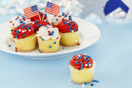 American patriotic themed cupcakes for the 4th of July. Shallow depth of field with selective focus on cupcake in foreground.