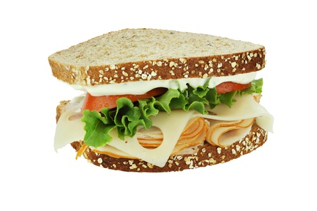 chicken sandwich: Smoked chicken sandwich with lettuce, tomato and swiss cheese on whole grain bread isolated on a white background.   Stock Photo