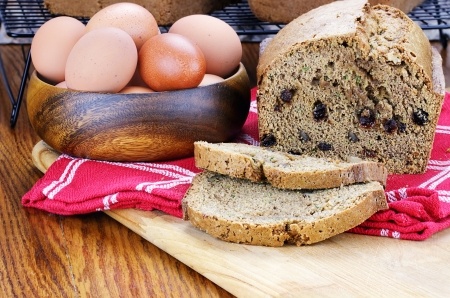 baked goods: Freshly made and sliced zucchini bread with fresh eggs.