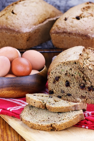 Freshly made and sliced zucchini bread with fresh eggs.   photo