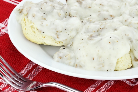 Homemade biscuits and gravy with sausage   photo