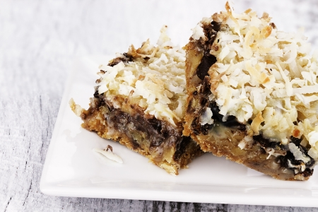 chocolate bars: Two coconut chocolate chip bars over a rustic background.
