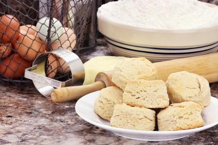 wire pin: Country biscuits with fresh butter, eggs and flour. Shallow depth of field.  Stock Photo