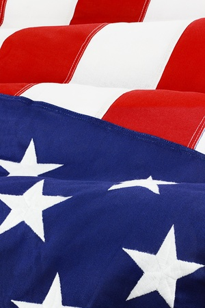 vertical: Close up of American flag waving in wind.