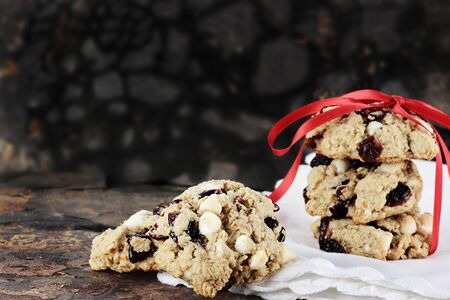 oatmeal cookie: Cranberry, oats and white chocolate chip cookies over a rustic background.  Stock Photo