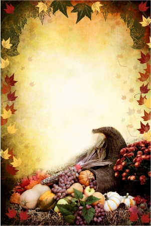 Photo based illustration of an autumn background with a Cornucopia or Horn of Plenty on bales of straw with fresh vegetables and fruit spilling out. Empty copy space for text.