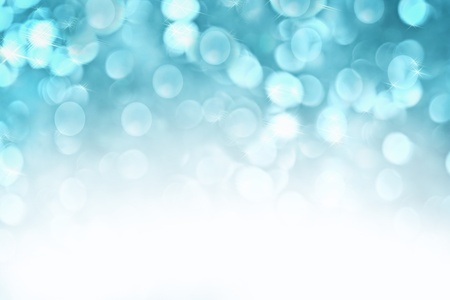 defocus: Abstract background of icy blue holiday lights with copy space.