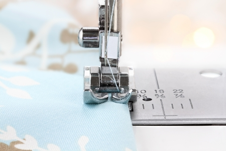 shallow depth of field: Close up of a sewing machine needle and fabric. Shallow depth of field.