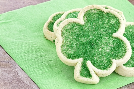 Freshly baked St. Patrick's Day sugar cookies on a green napkin. 