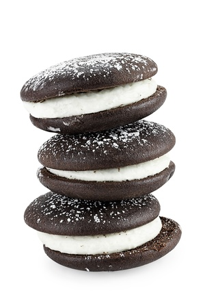 Stack of whoopie pies or moon pies isolated on a white background with light shadow. Clipping path included.