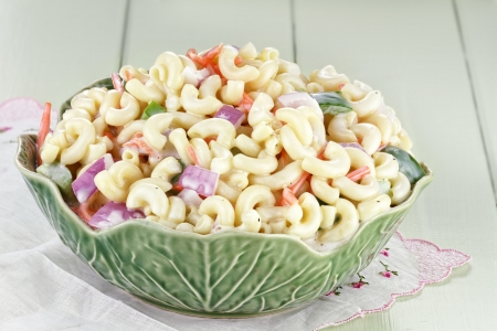 elbows: Macaroni salad with mayonaise and vegetables.  Stock Photo