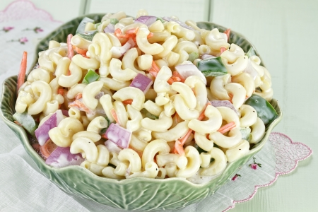 side salad: Macaroni salad with mayonnaise and vegetables.