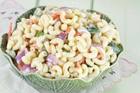 pasta salad: Macaroni salad with mayonnaise and vegetables.