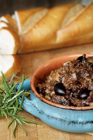 Fig Tapenade prepared with figs, kalamata olives and fresh herbs. photo
