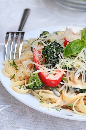 primavera: Pasta Primavera made with fresh broccoli, asparagus, red bell pepper and zucchini and served with freshly grated parmesan cheese.