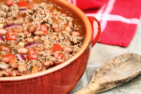 Chili Con Carne in a red ceramic pot.  photo