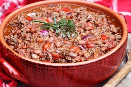 Chili Con Carne in a red ceramic pot.