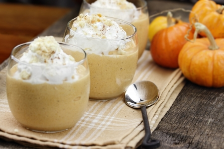 Three fresh Pumpkin Smoothies against a rustic background with shallow depth of field  Selective focus on center smoothie