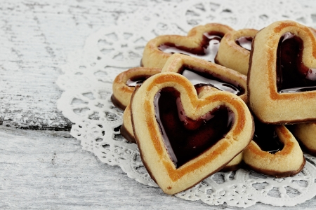 Heart shaped shortbread cookies in a circle on a rustic background.
