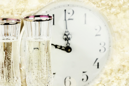 past midnight: Glasses and clock at midnight on New Years Eve.