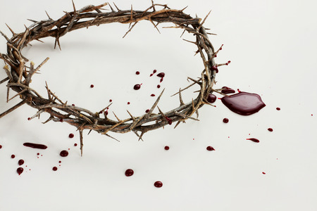 Crown of thorns with blood over white background  photo
