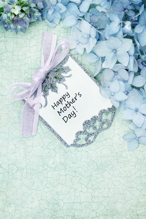 Mothers day card and flowers over green craquelure background