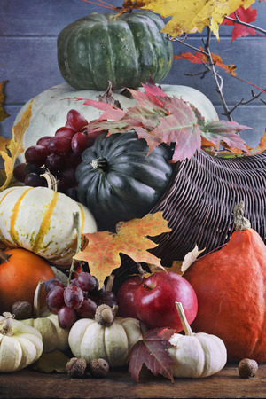 harvest cone cornucopia: Retro or vintage image of a Cornucopia or Horn of Plenty with lots of fresh vegetables and fruit spilling out.