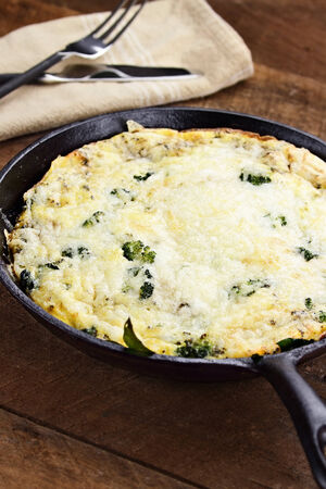 Fresh golden, broccoli, mushroom and spinach frittata with shallow depth of field. photo