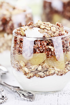 whole pecans: Three bowls of red quinoa with apples, yogurt and granola with shallow depth of field.