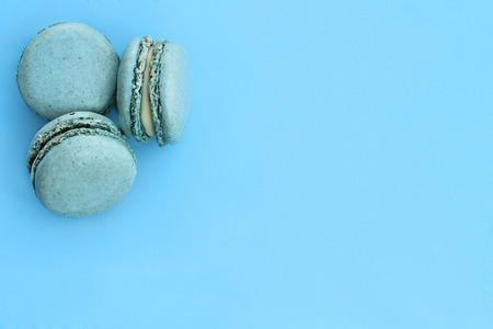 room for copy: Blue macarons over blue background with room for copy space. Stock Photo