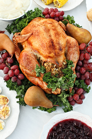prespective: Whole homemade Thanksgiving Turkey with side dishes shot from above. Stock Photo