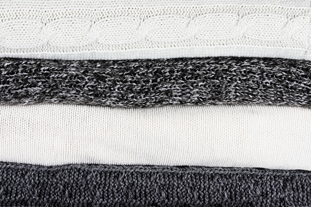Stacked sweater or knit blanket texture background. Фото со стока