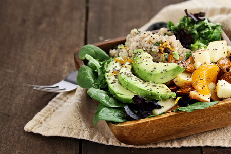 Quinoa, avocado and apple salad. Perfect for the detox diet or just a healthy meal. Selective focus with extreme shallow depth of field. Stock Photo