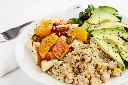 salad greens: Quinoa, avocado and apple salad. Perfect for the detox diet or just a healthy meal. Selective focus with extreme shallow depth of field. Stock Photo