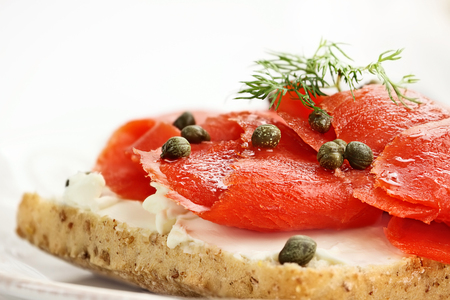 food photography: Ciabatta with Salmon, Cream Cheese and Capers. Extreme shallow depth of field with selective focus.