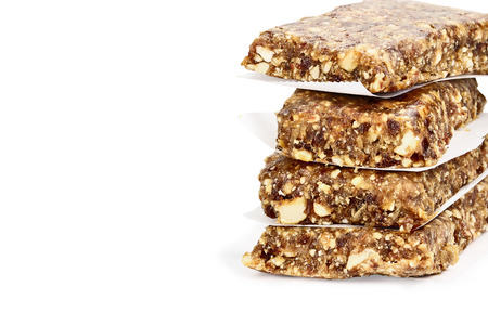Isolated Medjool Date and Cashew Protein Bars isolated on white with light shadow and clipping path.