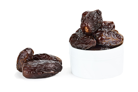 light and shadow: Dried Medjool Dates over a white background with light shadow. Stock Photo